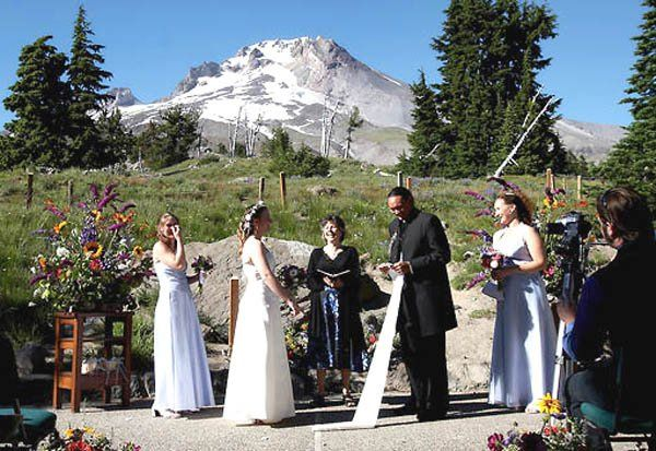 """John unrolling his """"vows"""" to Jessie under the  gaze of Grandfather Mountain at Timberline"""