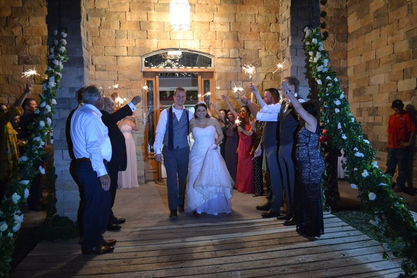 Guests cheering for newly weds
