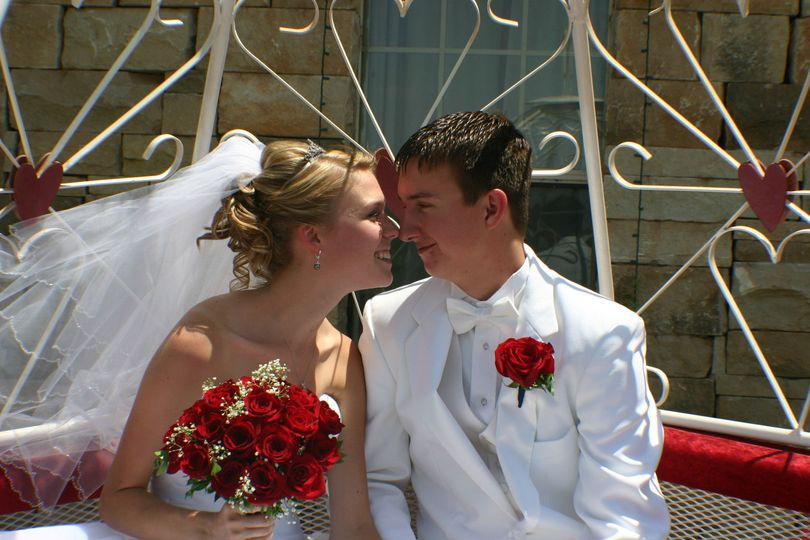 Newly weds kiss in a carriage