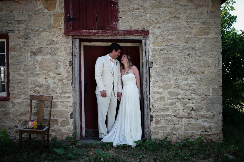 Wedding couple in the doorway of the rustic stone building