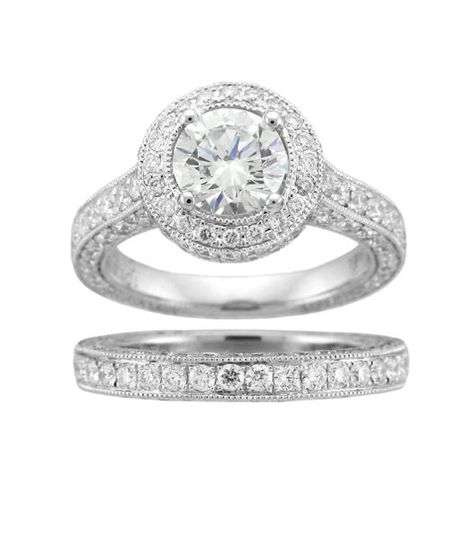This elegant matching engagement ring and band are set with round diamonds.