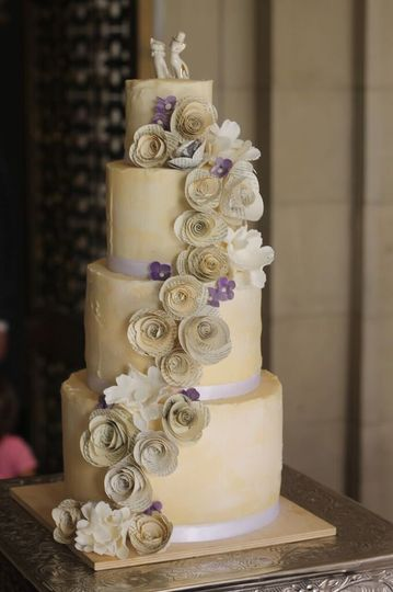Four tier cake with ascending flowers