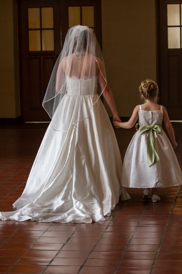 Unposed shot of bride and flower girl