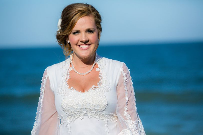Bridal Portraits on Tybee Island The bride in her mother's wedding gown!