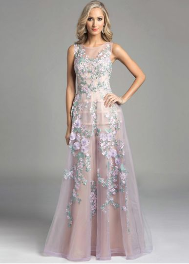 Couture inspired gown with caged skirt detail and colorful floral embroidery. Available in the...