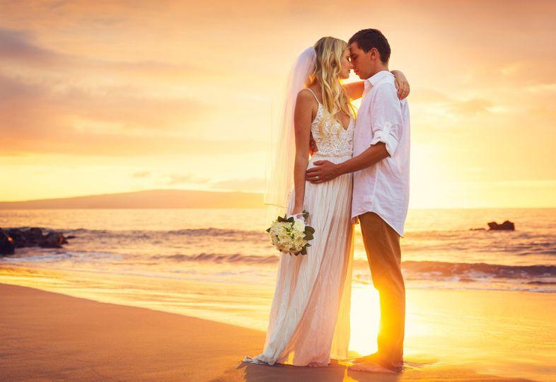 Beach sunset wedding