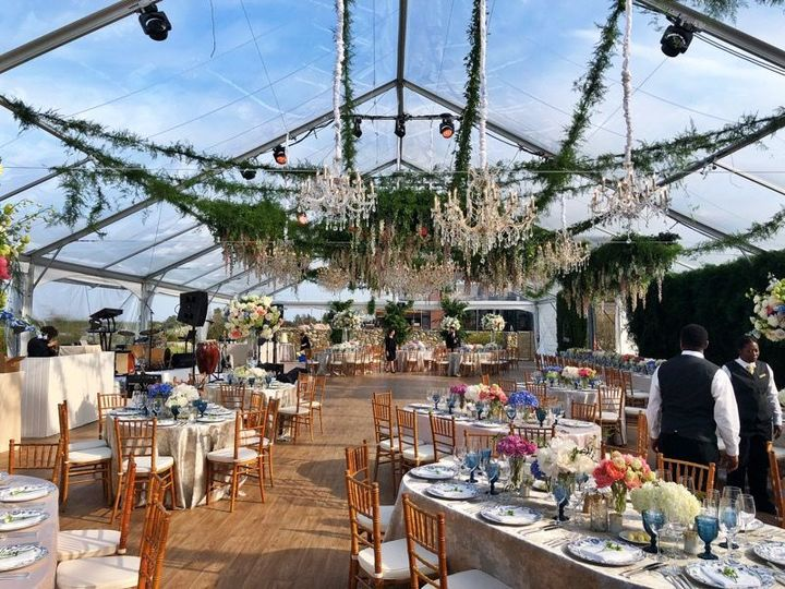 Clear tent roof and hanging floral decor