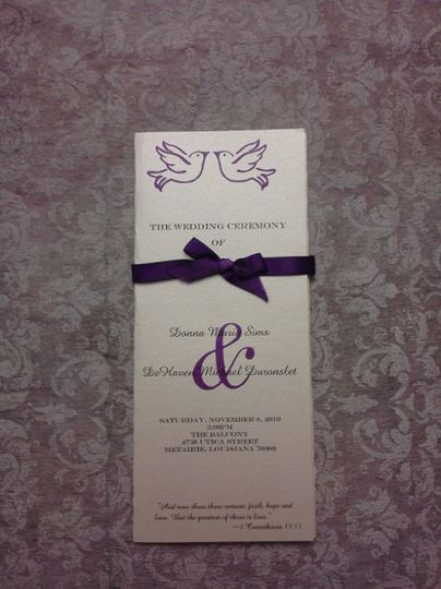 Trifolfd wedding program with ribbon