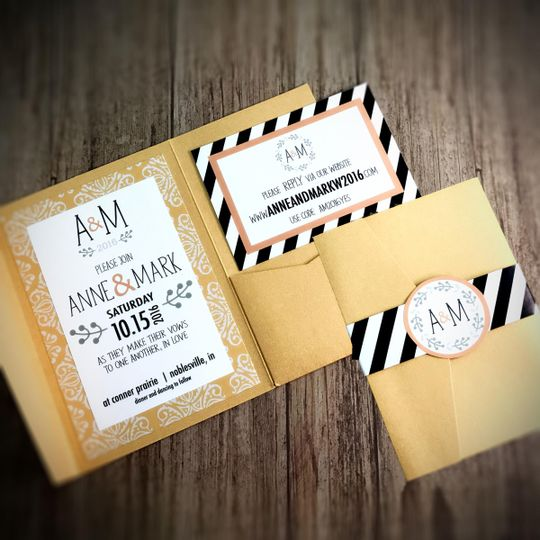 Gold invitation with black and white stripes