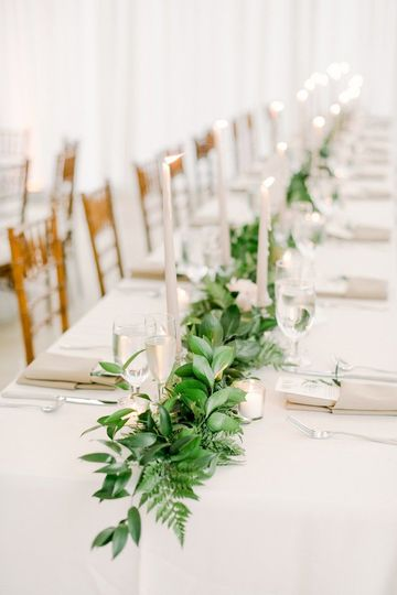 An elegant garland with votive candles