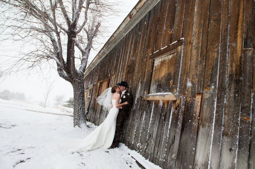 Couple kiss by the barn