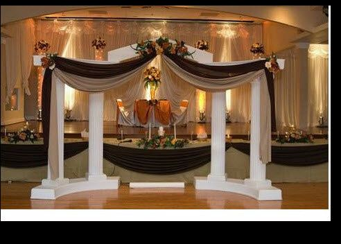 We carry Colonnades to set up your stage. Can be set up with any colors of linens and flower...