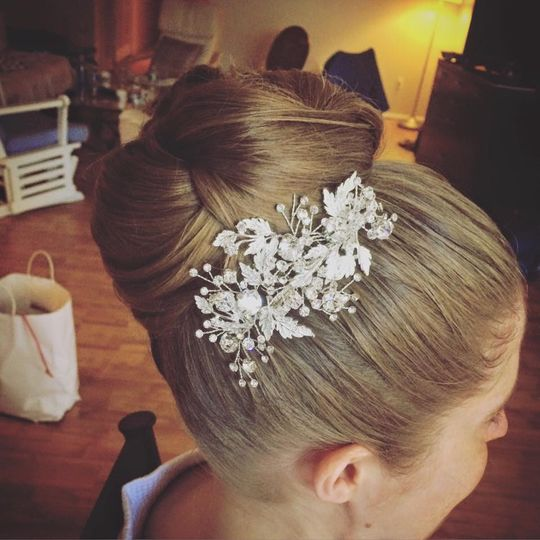 Clena updo with hair accessory