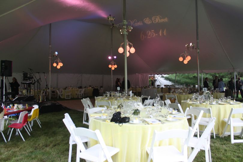 Interior of 60' x 70' century pole tent with extensive colored uplighting.