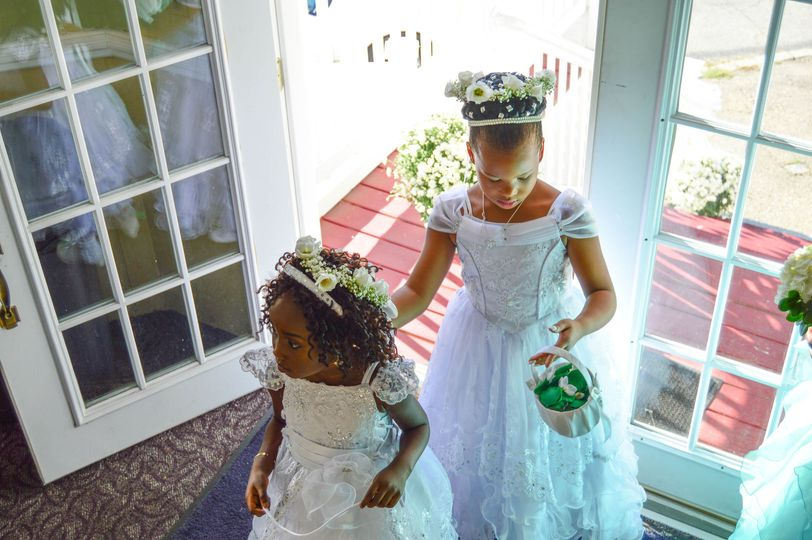 Little girls with basket of flowers