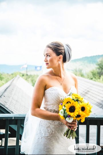 A wedding full of Sunflowers.  Photo credit goes to Kate Michaud Photography.