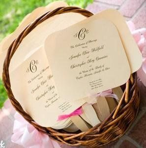 Programs made into fans for outdoor wedding