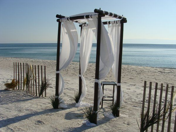 The wind fence and natural grasses make this romantic beach location perfect.