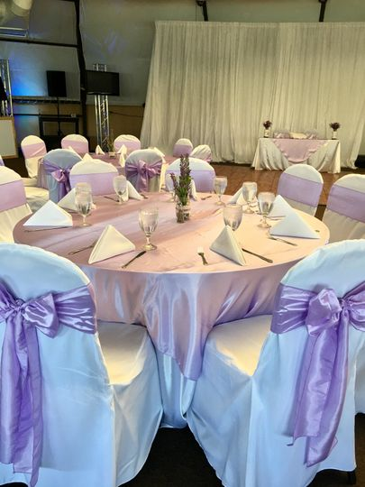 Lavender overlay with satin white tablecloths