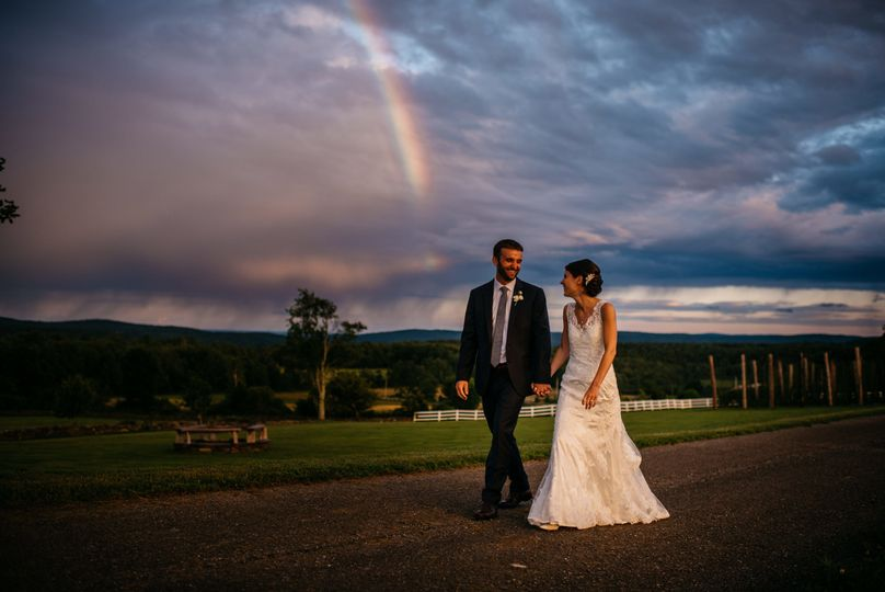 Rainbow in the backdrop as newlyweds walk