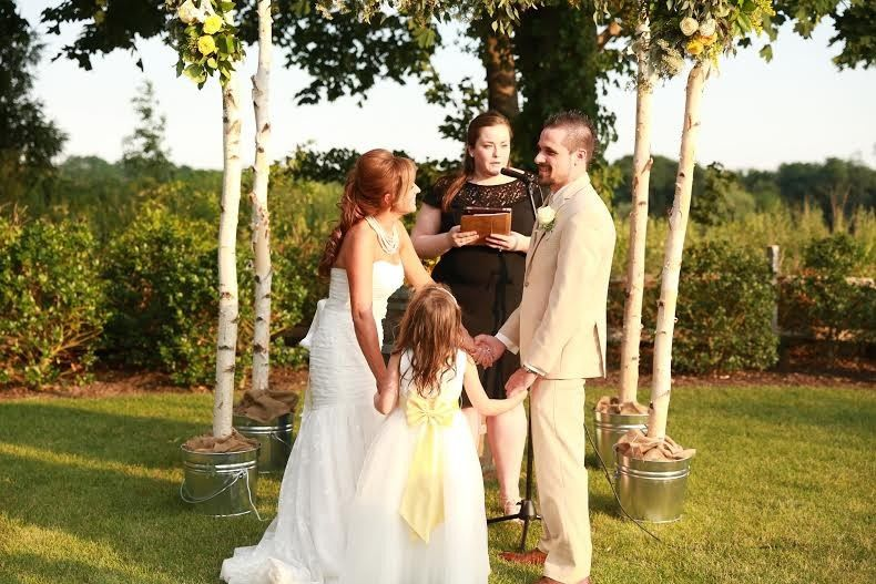 Toni, Anthony & Madelynn share a laugh during their ceremony at Sherwood Tasting Room  *Photo...