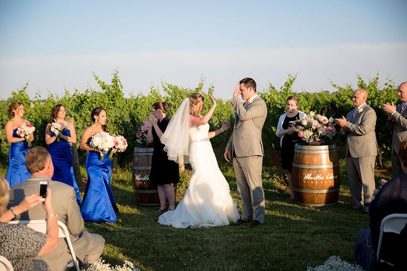 Jay & Amy high five before their big kiss at Martha Clara Vineyards  *Photo courtesy of Sandy Ruffio