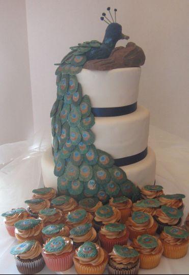 peacock wedding cake with cupcake tail