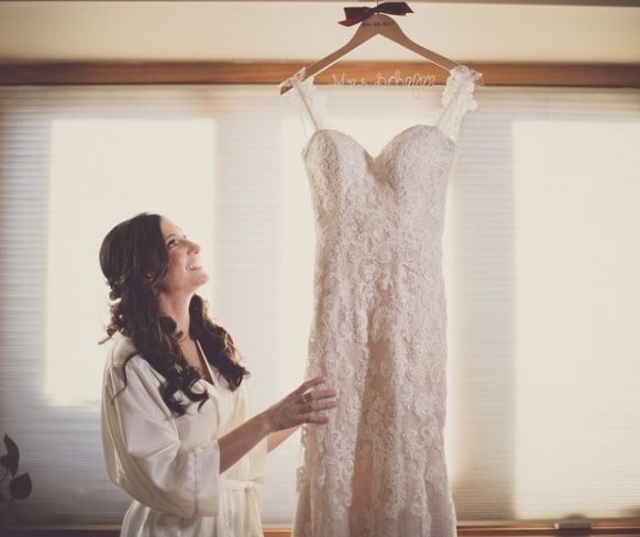 Bride looking at her wedding gown