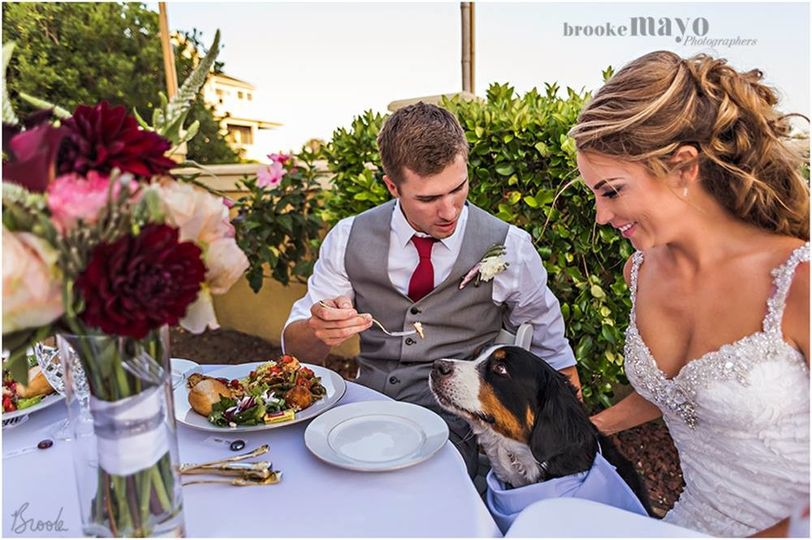 Groom and Bride enjoying Mulligan's Beach Catering during their reception.