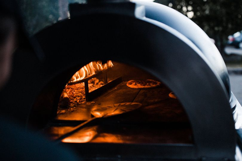 Live wood fired oven with chef