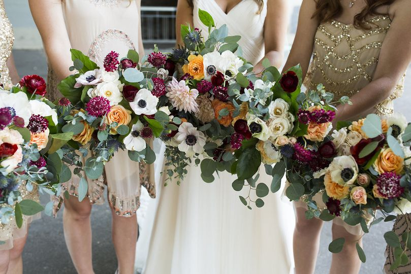 Garden Bouquets of blush and champagne with pops of cranberry and orange.