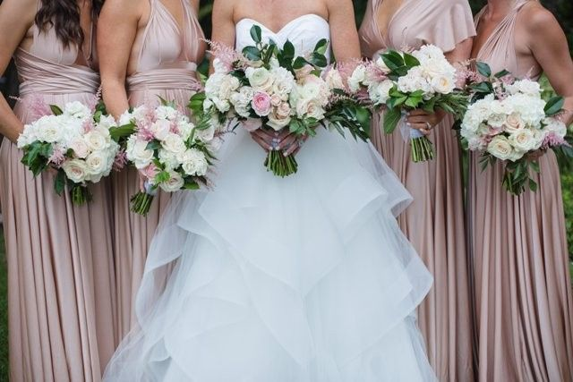 Soft romantic bouquets in white, ivory and blush.