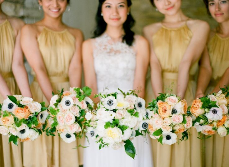 Soft yellow, orange and peach bouquets.