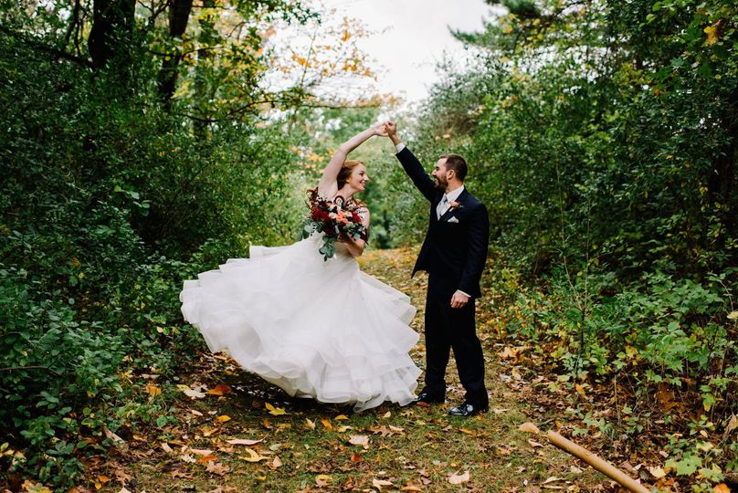 Newlyweds dancing in the forest