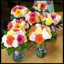 Fresh bridesmaid bouquets of colorful gerbera daisies and roses.