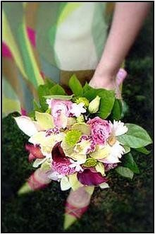 Fresh bridesmaid bouquet of orchids, calla lilies, lisianthus, and gerbera coordinates beautifully...