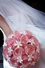 "Nothing says ""wedding"" like a timeless and classic rose and stephanotis bouquet. Note that this..."