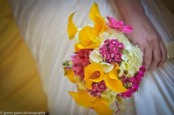 Yellow, white and pink brides bouquet with callas, stock, sweet william and more.