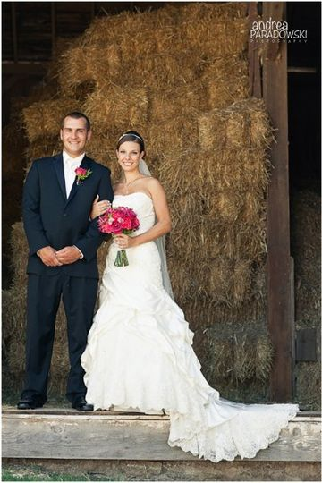 Pink brides bouquet in a rustic barn setting.
