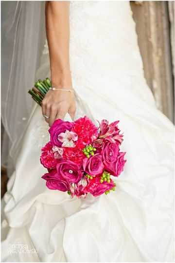 Pink brides bouquet of roses, alstroemeria, carnations and hypericum berries.