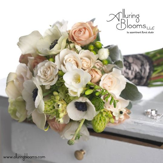 White, blush and green brides bouquet of ranunculus, callas, roses, spray roses, star of bethlehem,...