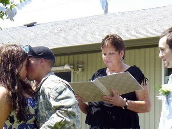 Officiant reading the script