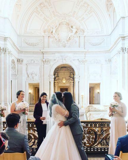 Newlyweds kiss    Photo by JVL Photography