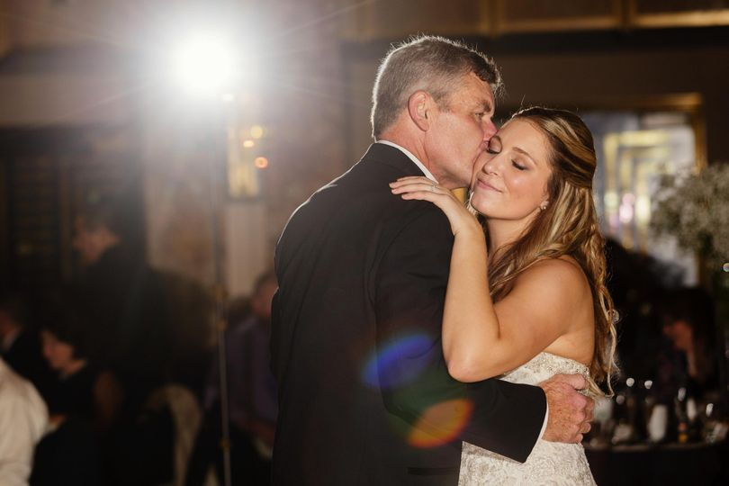 Groom kissing his wife on their wedding dance