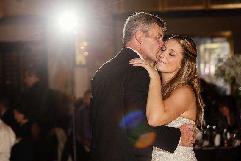 Groom kissing his wife on their wedding dance