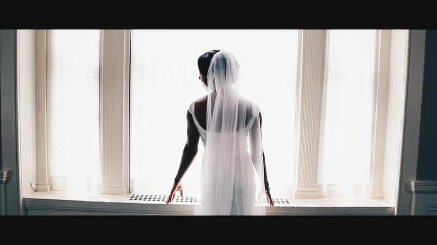 Bride beside the window