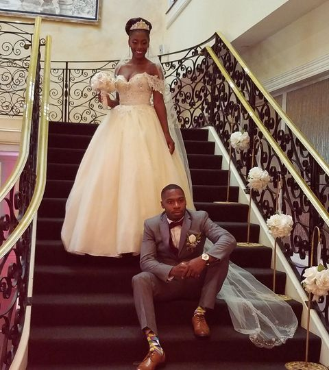 Bride and groom by the stairs