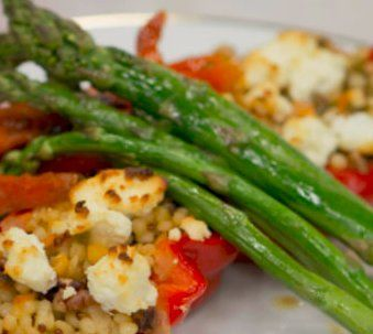 Vegetarian cous cous stuffed peppers with fresh asparagus