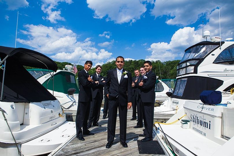 Groom and groomsmen by the yachts