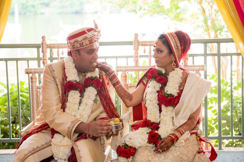 Bride feeding her groom